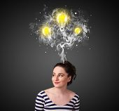 Pretty young woman with smoke and lightbulbs above her head