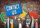Hands Holding Digital Devices and Symbols Contact Us