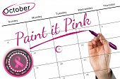 Businesswomans hand writing with marker against breast cancer awareness message in pink