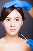 Asian Beautiful Woman Gets Injection Into Her Mouth. Aesthetic Medicine Concept.