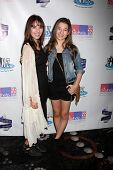 LOS ANGELES - OCT 19:  Haley Pullos, Stephanie Katherine Grant at the First Annual Stars Strike Out Child Abuse event to benefit Childhelp at Pinz Bowling Center on October 19, 2014 in Studio City, CA
