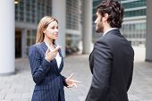 Discussion between business people