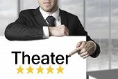 Businessman Pointing On Sign Theater Five Stars
