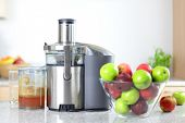 stock photo of juices  - Apple juice on juicer machine  - JPG
