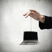 Close up of business person hand holding laptop on rope