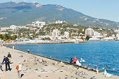 Tourist On Waterfront Of Yalta City In Crimea
