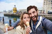 pic of selfie  - couple eating icecream taking selfie on holiday vacation travel - JPG