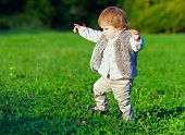 Cute Baby Girl Making First Steps, Colorful Outdoors