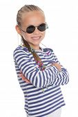 Cute little girl in sunglasses isolated on white background. Girl is six years old.