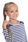 Adorable little girl holding dreadlocks. Six years.