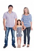 Portrait of a happy family in a full length isolated on white background