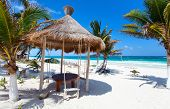 Beautiful tropical white sand beach and Caribbean sea in Tulum Mexico