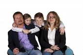 Cute Family Posing On White Background