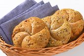detail of fresh bread buns and blue napkin in basket