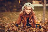 young girl in autumn park