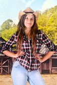 stock photo of sassy  - A sassy young teen cowgirl in an old western town - JPG