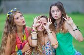 pretty group of teens girls blowing kisses.