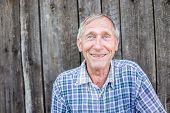 Happy smiling elder senior man portrait