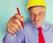 Happy smiling senior engineer closeup portrait with pen writing on abstract background copy space