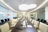 MOSCOW, RUSSIA - APR 10, 2014: Bright conference room in office of Moscow Stock Exchange: glass walls, long table with microphones