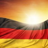 German flag in front of bright sky