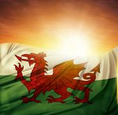 Welsh flag in front of bright sky