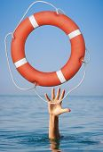 Lifebuoy for drowning man's hand in open sea or ocean water.