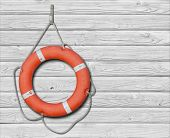 Lifebuoy on wood white background