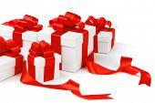 White gift box with red ribbon bow isolated on white background close-up