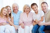 Joyful family in casual looking at camera
