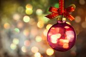 Christmas  bauble over Beautiful magic bokeh background -  horizontal