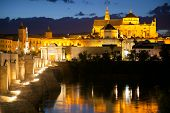 Famous Mosque (Mezquita) and  Roman Bridge at night with illuminations, Cordoba, Andalusia, Spain, Europe