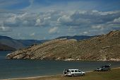 Two Cars On The Shore Of The Lake Baikal