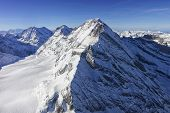 Jungfrau Peak Helicopter View With Snow Flow