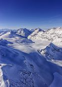 Valley And Mountain Ridge In Jungfrau Region Helicopter View In Winter
