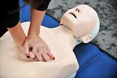 stock photo of mannequin  - Hands of a woman are seen on a mannequin during an exercise of resuscitation
