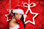 Woman blowing kiss to camera against blurred christmas background