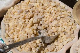 picture of magi  - Frankincense and myrrh in a spoon inside a ceramic container - JPG