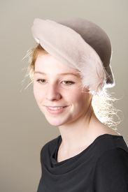 picture of taupe  - Smiling redhead in taupe hat looking down - JPG