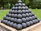 stock photo of battlefield  - Cannonballs stacked up at a civil war battlefield - JPG