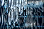 pic of fin  - Abstract detail of the exterior of an air conditioning unit showing damage to the fins - JPG