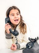 pic of 7-year-old  - Seven year old girl with old vintage phone before white background - JPG