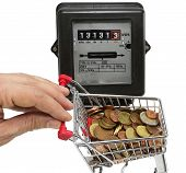 image of electricity meter  - hand pushes a cart of European money to pay the electricity bills - JPG