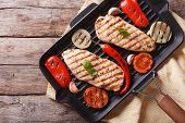 picture of  breasts  - Chicken breast with vegetables and spices in a pan grill closeup - JPG