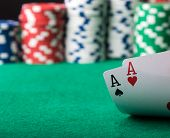 foto of poker hand  - two poker cards aces with poker chips in the background - JPG