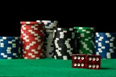 stock photo of dice  - red casino dices and poker chips on green table - JPG