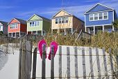 stock photo of beach-house  - A colorful row of beach rentals on a summer day - JPG
