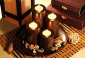 picture of casket  - Composition of four decorative candlesticks in the Japanese style on a background of bamboo caskets - JPG