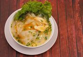 picture of glass noodles  - Glass noodle soup with chicken and beansprouts on a wood table top background - JPG