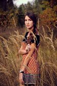 picture of auburn  - cute young woman with long auburn hair in the autumn field - JPG